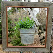 framed lobelia bucket, gardening, I drilled a small hole in the top of the frame and strung a wire through to hold the pail to the frame and the frame to a hook in the tree