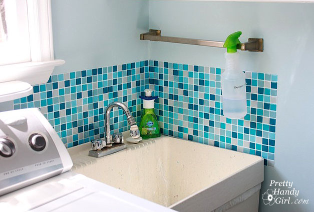 Smart Tile adhesive tile sheets (they are like stickers) surround the utility sink to keep the walls clean and can be easily wiped.
