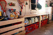 organized garage and workshop, garages, organizing, storage ideas, Storage built into sides of garage for paint and kid s toys