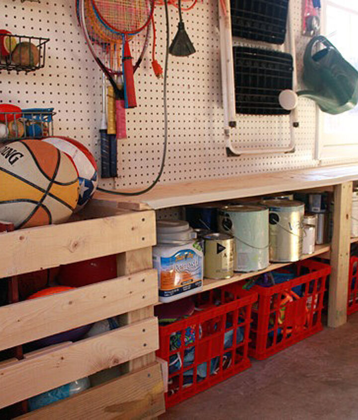 Storage built into sides of garage for paint and kid's toys