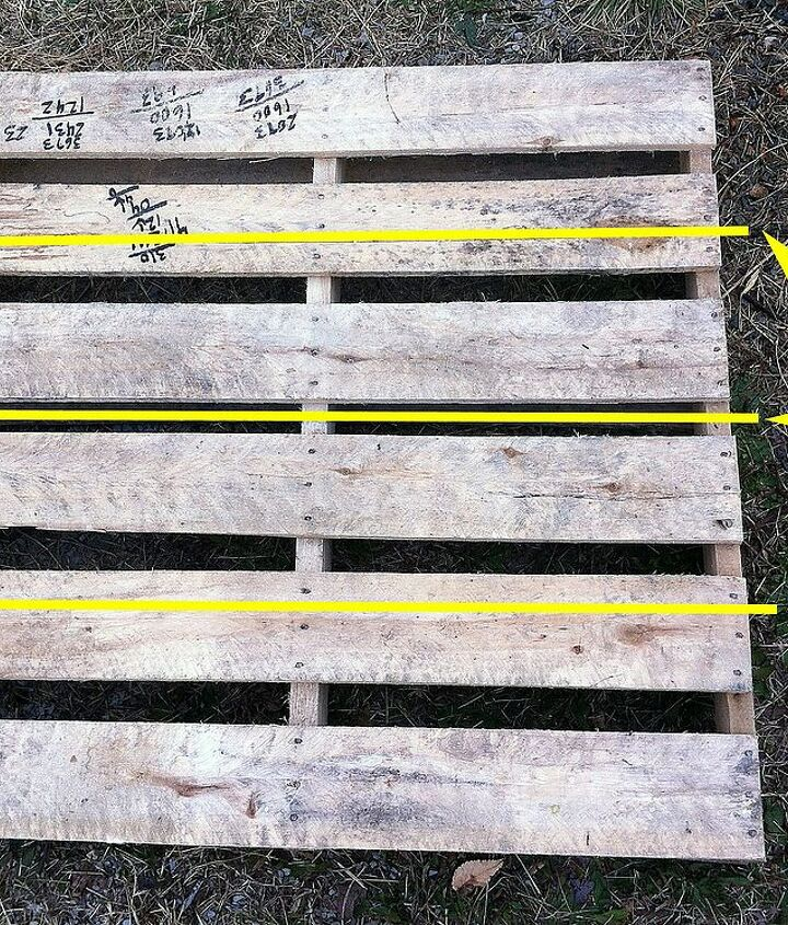 1. Measure and make lines to cut the 2nd board (on the top) a little past halfway. Do this on the other side as well. Lastly make a line to cut the pallet directly in half.