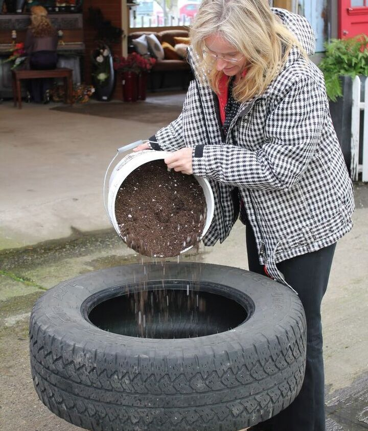 Step 4:  Add soil.  Choose a container mix suitable for Bedding Plants.  Ensure that you fill the tire completely.