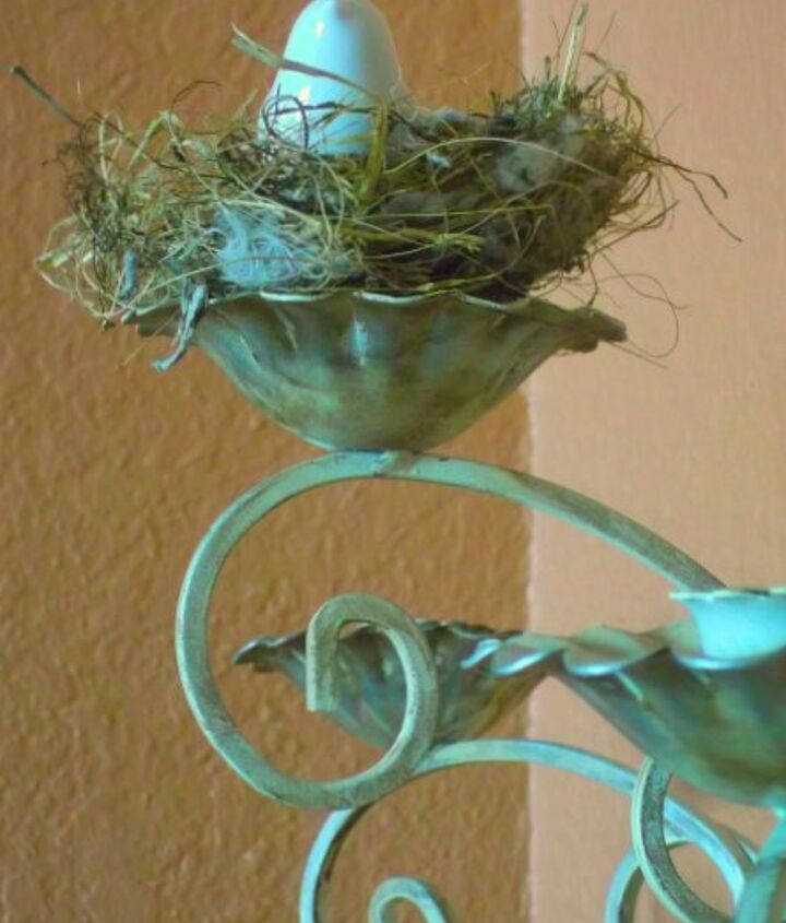 My mom bought this sconce at a garage sale and gifted it to me.  It was originally brass.  I painted in white then aged it. I love the faux patina.  That's real nest and the bird is from a salt and pepper set.