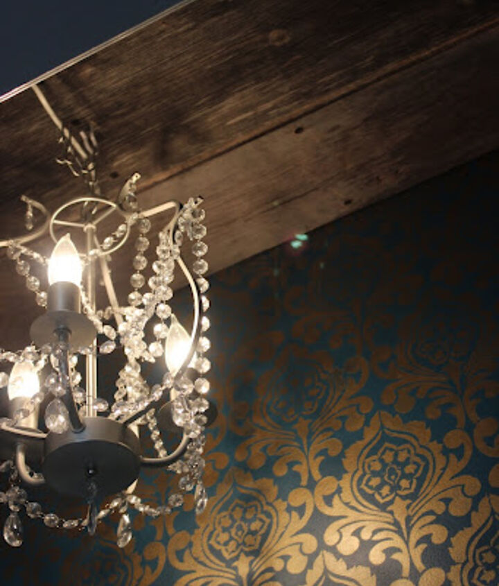 Adding some barn wood in the ceiling to contrast with the stenciled wall and chandelier.