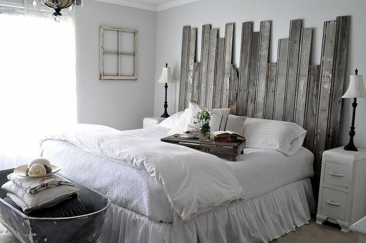 """White bedding, """"Silver Drop"""" paint by BEHR, with the reclaimed headboard creates a romantic farmhouse bedroom."""
