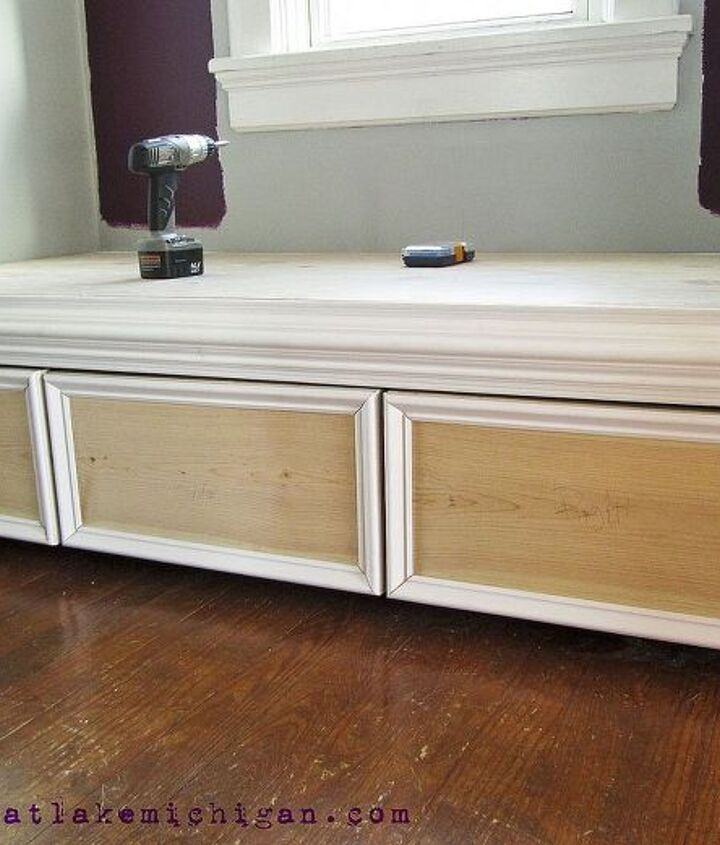 The drawers are on casters for easy access, and we added picture rail trim to give them a more built-in look. We also added chair rail to the front of the seat for the same reason.