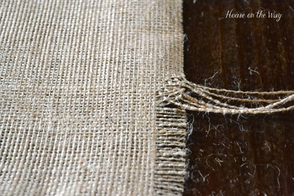 After cutting the burlap, pull multiple threads until you create the size fringe that you want on each edge of the runner.