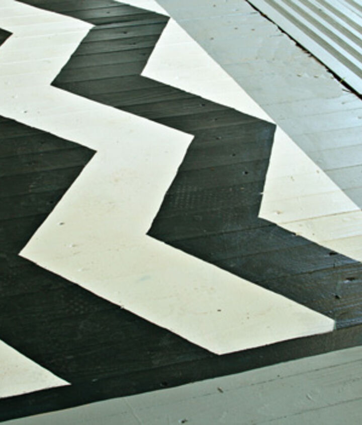 I painted a rug on the floor, easy to do and it adds the perfect splash of fun to the porch!