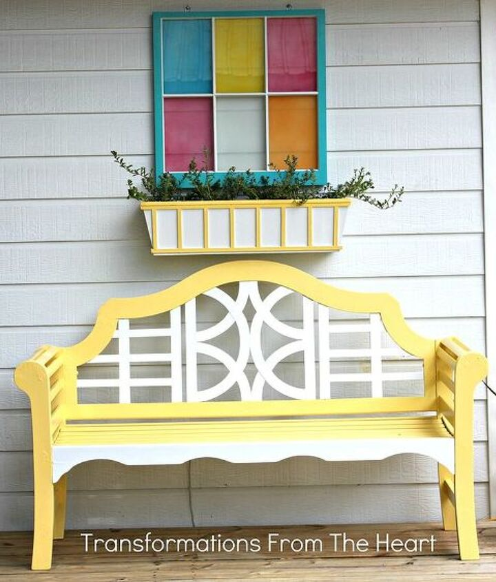 Teak wood bench, planter box and window frame make it a trio of color.