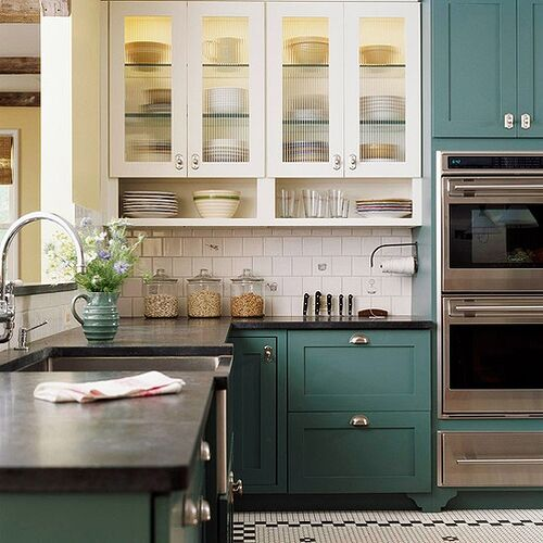 Darker lower cabs in a grey/teal. Photo is from House Beautiful.
