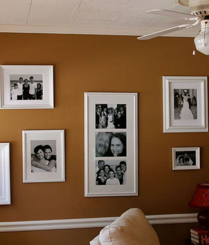 Hanging frames on wall.