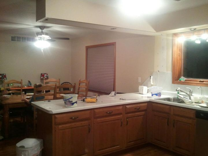 q i hate my ugly spindles under my cabinets do you have any ideas, kitchen cabinets, Looking into the dining room