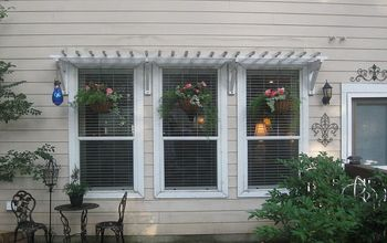 backyard retreat wooden awnings, curb appeal, diy, how to, Adding hanging planters completed the look