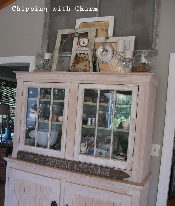 A hutch my husband made out of windows we bought on our honeymoon.