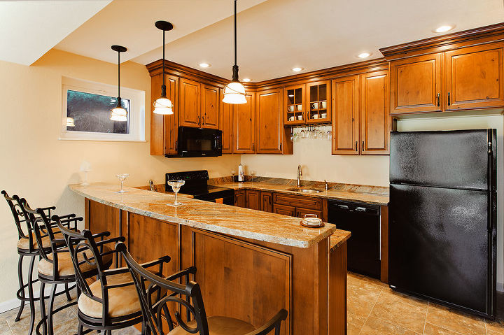 Full operating kitchen with rustic alder cabinets and granite countertops