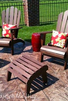 creating a gorgeous outdoor space, decks, outdoor living, Adirondack chairs with floral pillows and outdoor garden seat used as an end table