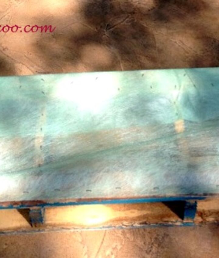 Landscape fabric (which can be purchased at most hardware stores) was attached to the back and bottom of the pallet with a staple gun.