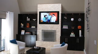 q what do i do with this fire place, fireplaces mantels, home decor, living room ideas, The new stacked stone fireplace with it s twin cabinets are now the focal point of this large living room