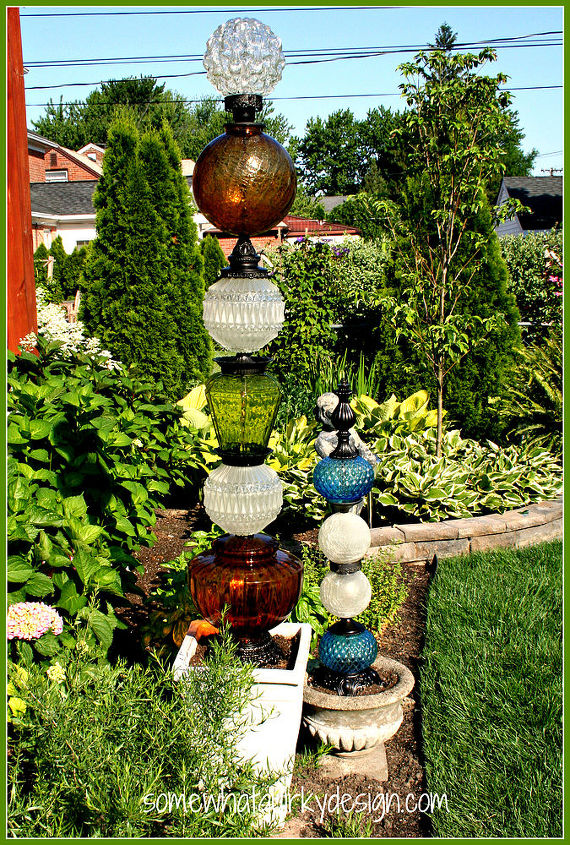 my glass tower vision has been fulfilled i built it, repurposing upcycling, They are beautiful with the sun shinning through