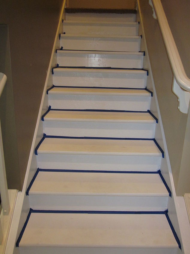 Apply painters tape and first coat of white paint to the risers