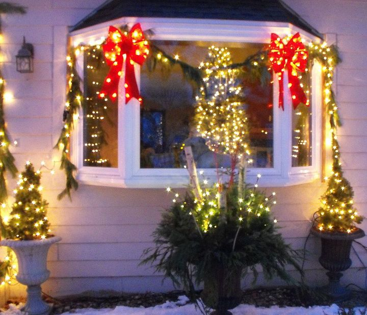 Theme of candy cane colors-red and white.  Colors really popped from the street! Winter container in the middle with twig lights.