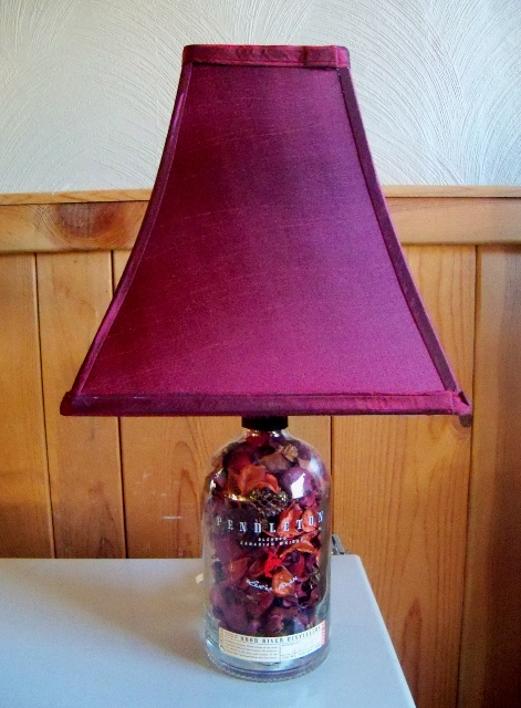Filled with red potpourri, added a burgundy shade. Nice lamp