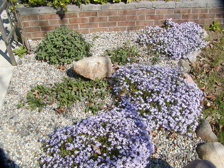 Pea gravel lets water flow though it to get to the soil below stone boarder holds in pea gravel and water.