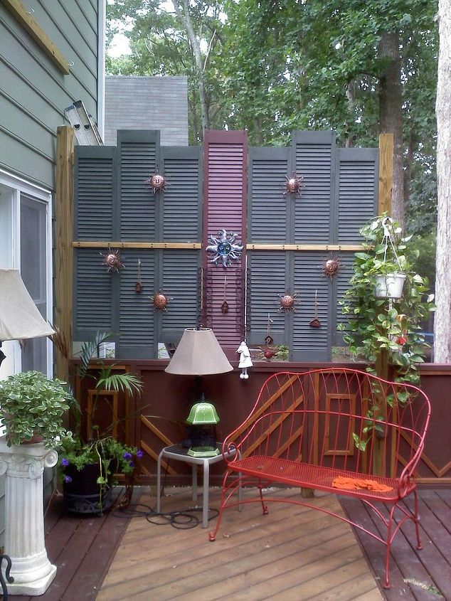 Old shutters at a garage sale for $2! makes a great screen on the deck.