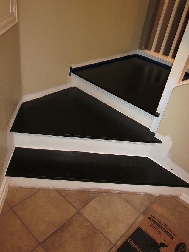 Apply painters tape and first coat of black floor paint to the landing
