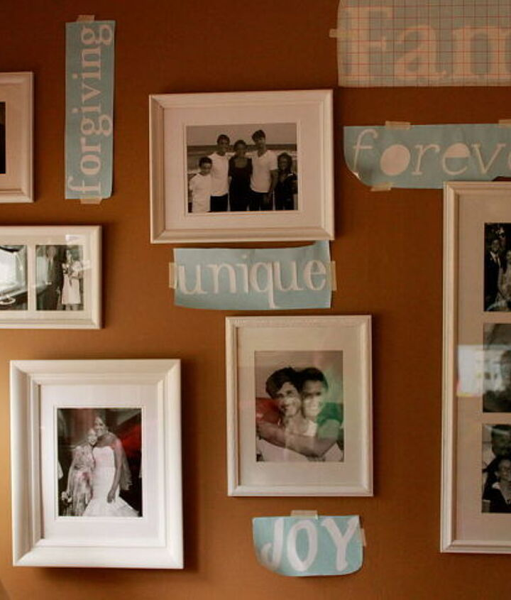 Pictures hung, placing vinyl words.