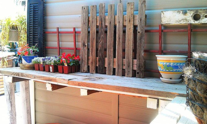 A piece of garden fence from a ranch.  This is the left side of the table with the wall to my aviary behind it.