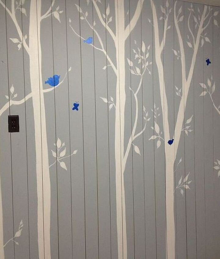 Here is the finished feature wall with the bright blue birds and butterflies just to add some fun.