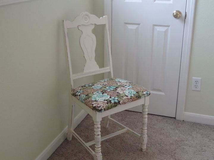 Bought the chair at a garage sale for $5. several years ago.  Painted, distressed and covered the seat.  The floral fabric is also on the rolled pillow on the bed.  The fabric ties all the colors together in the room.