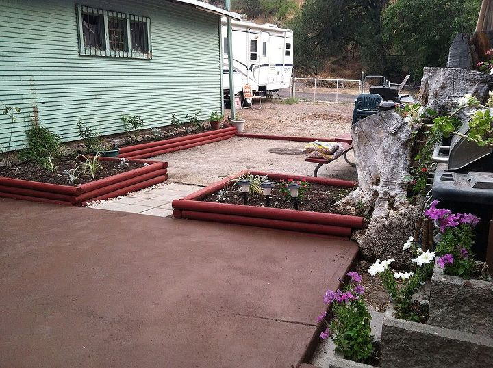 I used the dirt  that covered the patio to fill in the flower beds and painted the red wood. I then painted the 1st patio dark brown.