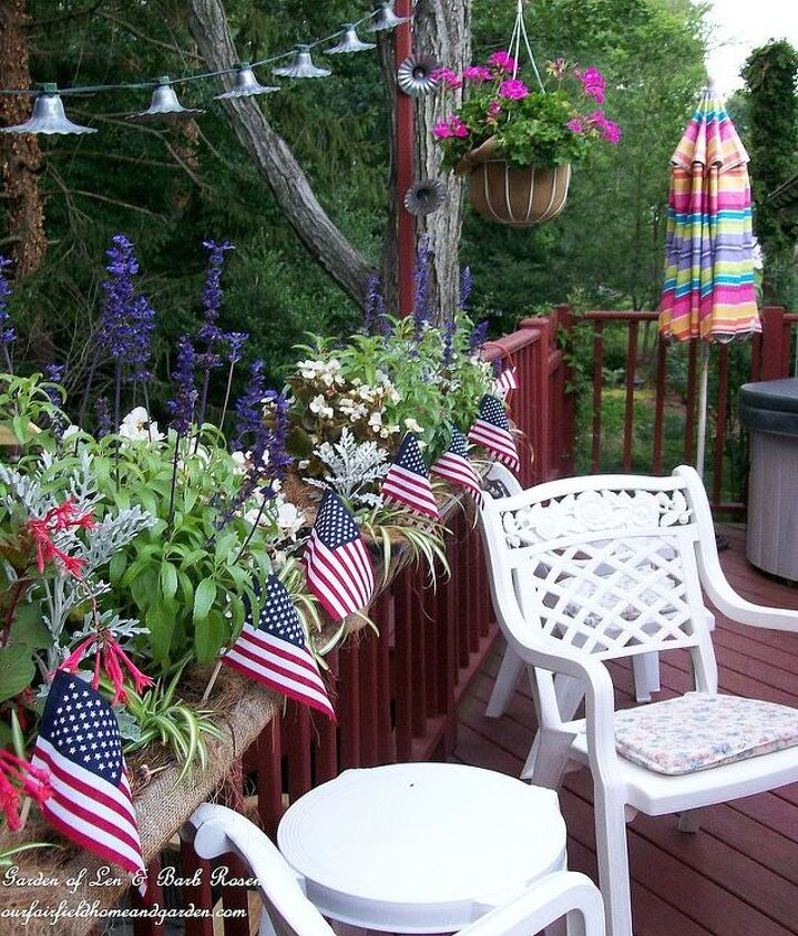 American flags were added to the deck planters planted with white begonias, blue ageratum and red fuchsias.