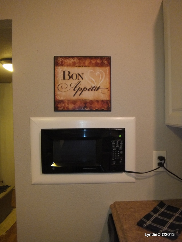 My Hubby cut a hole in the wall and installed the microwave to free up valuable room on the counter.