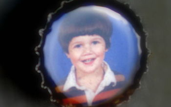 Turning your kids picture proofs into bottle cap magnets!