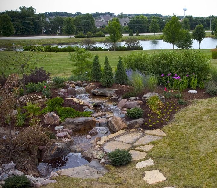 A large pondless waterfall fills the space of an expansive backyard ... which means less grass to mow!