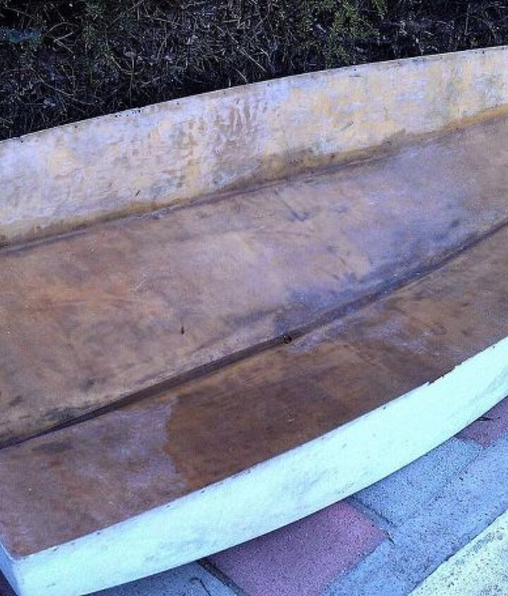"""I found this fiberglass boat hull for free on Craigslist so I took her home.  I already knew what I wanted to do with this and I liked the """"rusty"""" old weathered interior."""