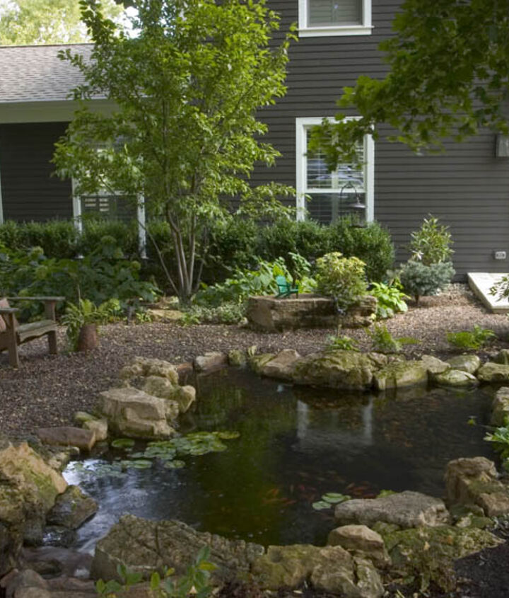 Who says a pond needs to stay in the backyard? This one greets visitors at the front door.