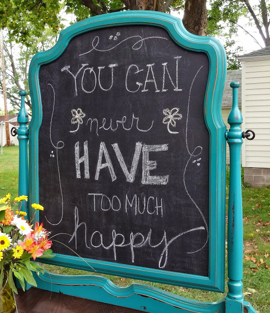 """and had my husband cut a piece of 1/4"""" board to fit the opening, then primed, and gave three coats of chalkboard paint.  I used glazier points to keep it in place."""