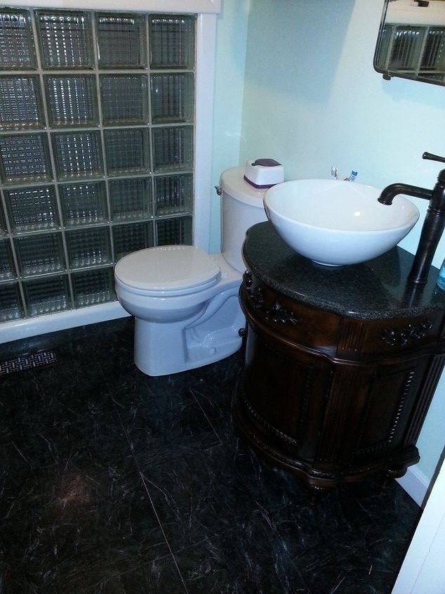 After, new toilet, vanity, sink & faucet, floors.  I'm very happy with the results and it only cost me about $800