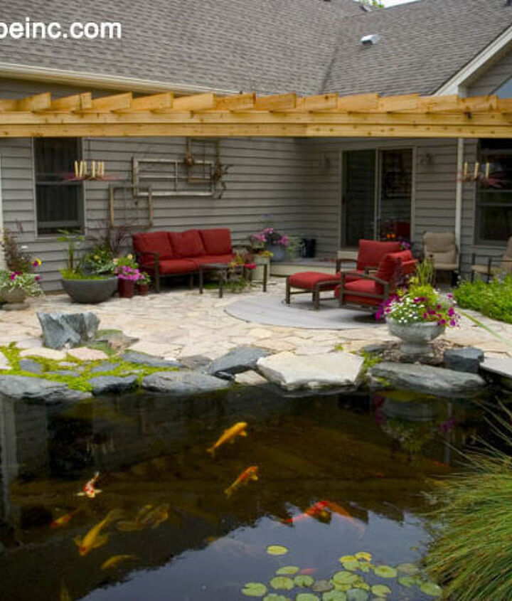 A mix of stone lends interest to the patio. The pond comes right up to the patio providing a great place to dangle your feet and feed the fish.