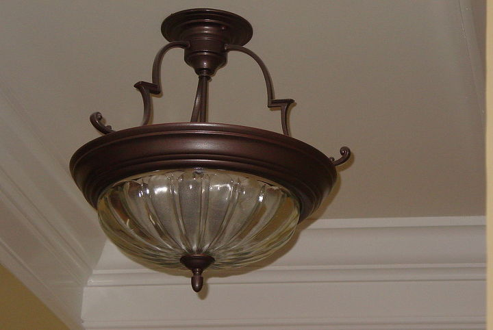This, too, came from Habitat Store.  $10.  I cleaned it up & repainted it a metallic bronze. It is hanging in our master bath.