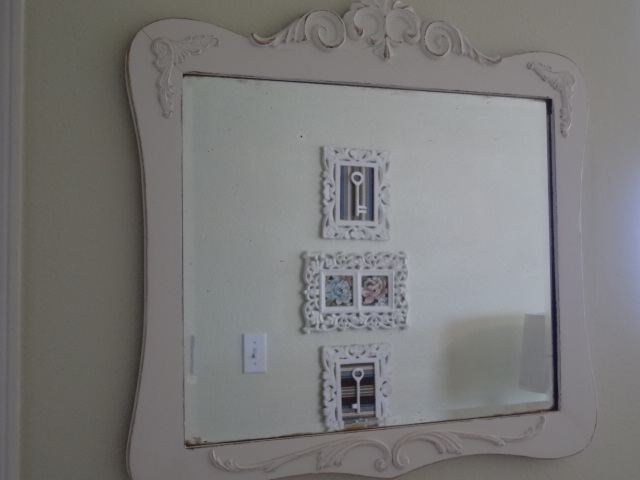 Painted and distressed this antique beveled glass mirror that was given to me a few years ago.