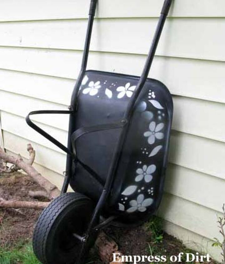 I made just one stencil, fitting the side of the wheelbarrow and used it for everything including the lawnmower.