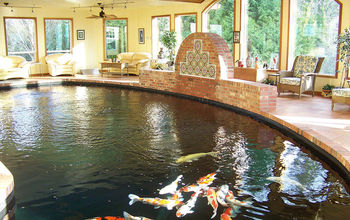 I designed and built this Koi pond for my clients show fish. It is over 39,000 gallons