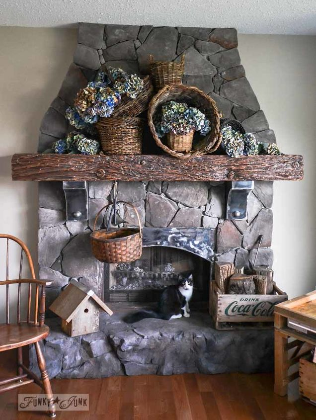 The fireplace mantel is wearing a new fall ou