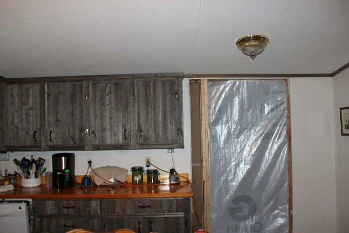 We were in the process of doing an add on.  That is why you see the plastic.  We added a big den/play room.  I am changing out light fixtures.  Want to make some out of white enamel pots I have.  Anyone done this?