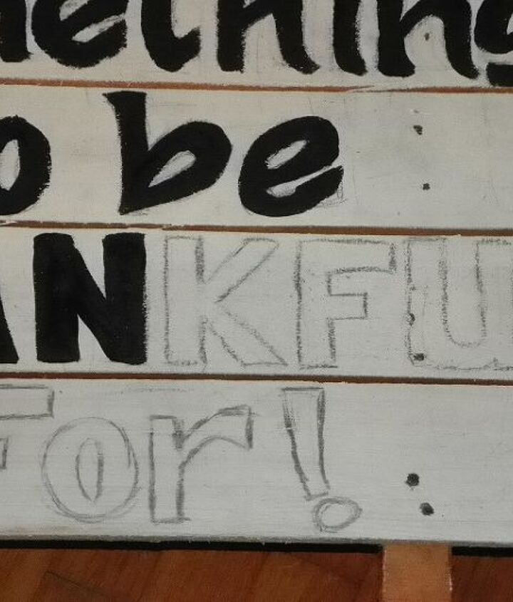 After painting the leaves on the pallet I then free handed the lettering of my saying on each board in lead pencil and then painted them with Black paint